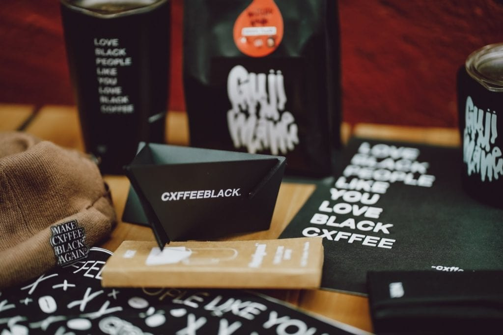 Several products from Cxffeeblack rest on a table.